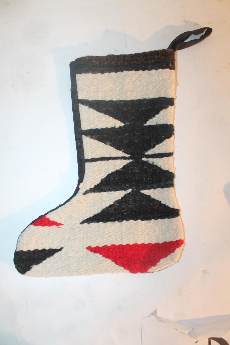 These handmade Navajo Indian weaving Christmas stockings are newly made from vintage weaving's. They make great gifts!! Sold as a pair. The backings are in black cotton linen. Only made for the holidays!
