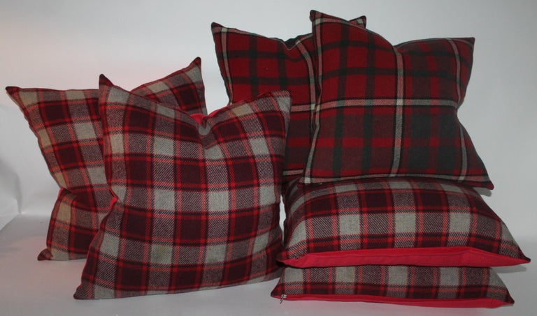These two different colors and pattern pillows are in pristine condition and have cotton backing. Two pairs of each in stock. The larger are in burg., red and grey blanket with red cotton linen backing 22 x 22.   The smaller plaid blanket pillows