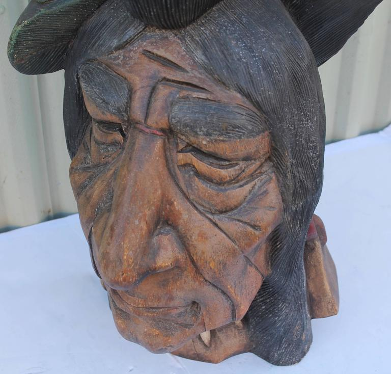 19th century hand-carved and painted cigar store Indian head. This size Indian head was used in the windows or store counters in the cigar shop. The heads are a little harder to find then the full body cigar store Indian. The face has been repainted