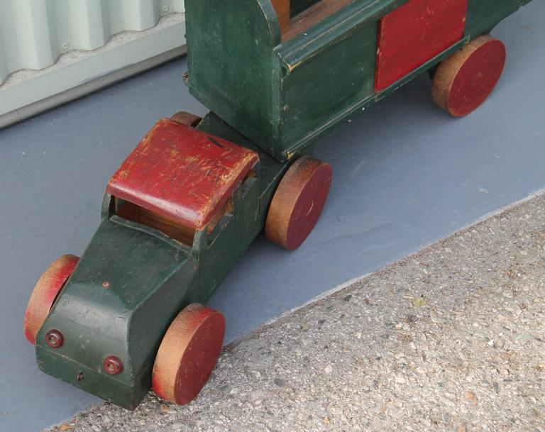 This handmade truck was found in the mid west and is unsigned. It is in working order. Probably from the 1930s. The condition is very good. Great on a shelf for display.