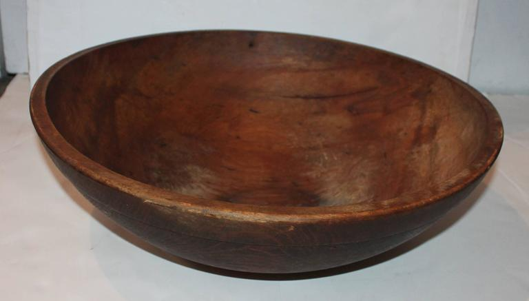 This large 19th century wood butter bowl is in great as found condition. There are minor age cracks but does not detract from the beauty of this bowl. Great for a collection of stone fruit or fresh fruit.