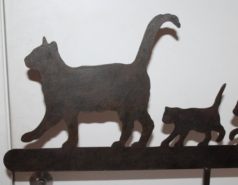 Early 20th century original worn painted folky cat weathervane on custom-made iron mount. This vane has fragments of black worn.