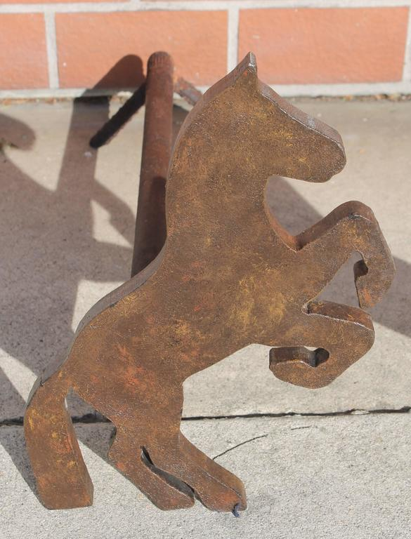 This pair of galloping cast iron horses are in great condition with wear consistent from age and use. There is fragments of old worn black painted surface. These are not manufactured, they are handmade!