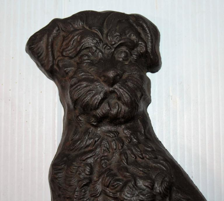 This large folky dog doorstop has a great look for a profile of his body. This iron dog has a makers mark of LB 71. Looks like Snoucher.