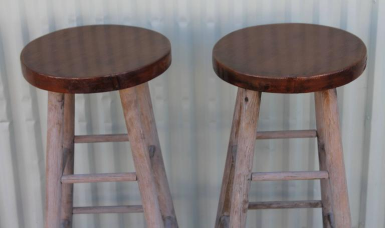 Pair of plank top and very distressed painted bar stools. They are sturdy and in good condition.