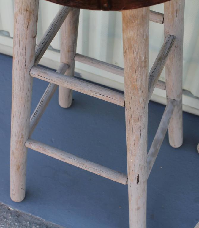 Pair of Rustic Original Painted Bar Stools In Distressed Condition For Sale In Los Angeles, CA