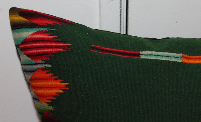 This handwoven Mexican weaving bolster pillow has amazing colors and in fine condition. The backing is in black cotton linen. The insert is down and feather fill.