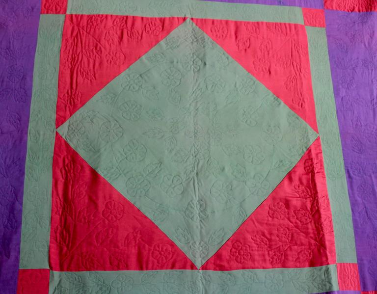 This amazing colorful and finely pieced and quilted quilt is in good condition with a few tiny sewn repairs. The quilt is comprised of wool and crepe fabrics, commonly used in Amish quilts. Then rust or red is in wool and the body of the quilt is in