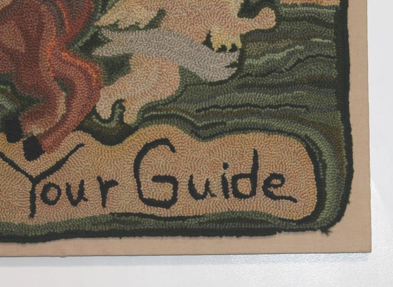 """This hand-hooked folky rug is signed and dated by the artist. It is dated 9-26-1992. It reads """"Let Love Be Your Guide"""" and shows the husband and wife with children in the forground. The condition is very good with hand-sewn on linen."""