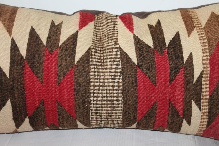 This early and graphic Navajo saddle blanket weaving bolster pillow is in wonderful condition with a brown cotton linen backing. Insert is down and feather.