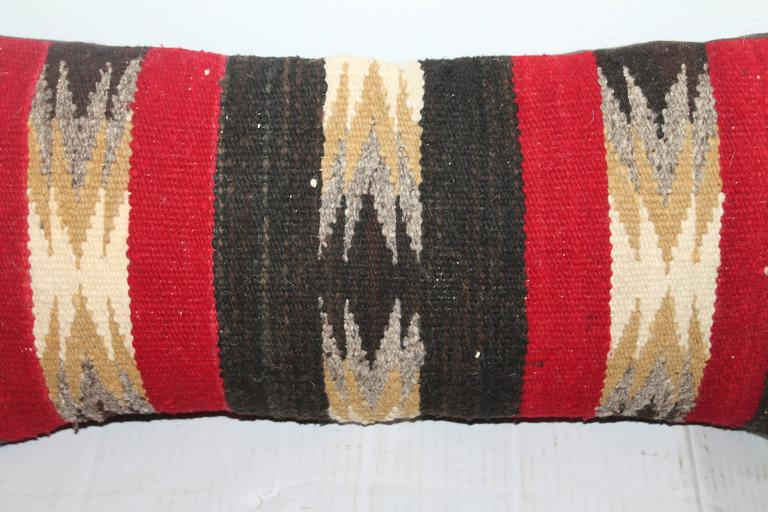 This amazing weaving pillow is in fine condition and is in a smaller scale. The backing is in a dark chocolate cotton linen backing.