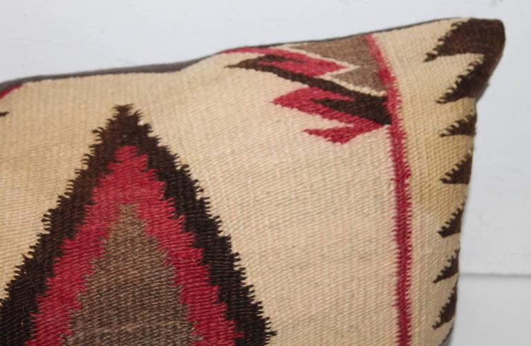 These most unusual colors of mauve and brown together in this geometric eye dazzler pillow. The backing is in a chocolate brown cotton linen.