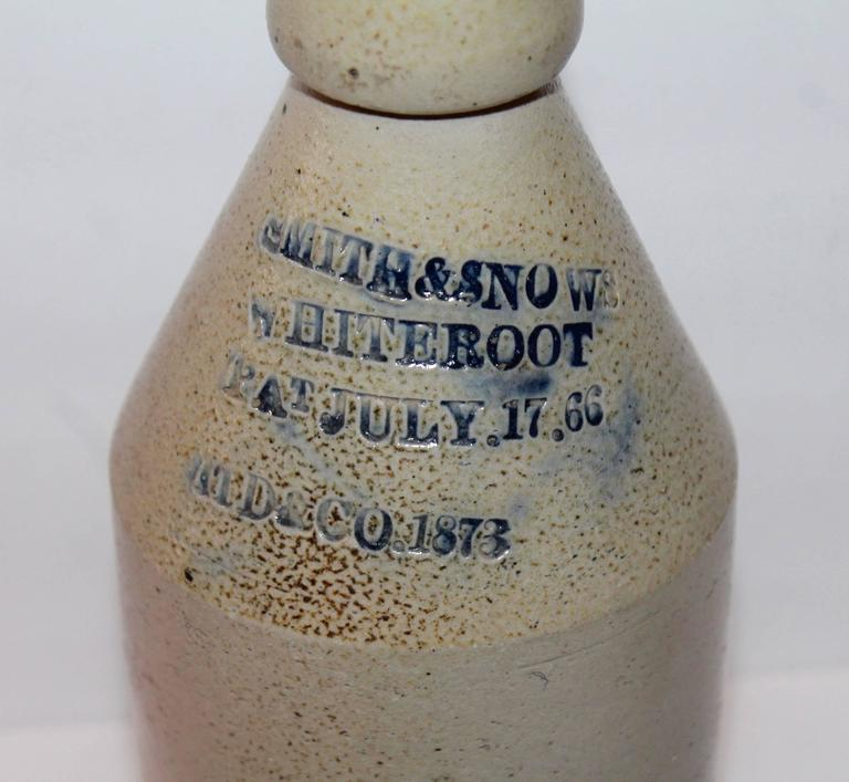 This early handmade pottery bitters bottle is signed and dated by the maker Pat. July. 17. 66 and Patd. & Co. 1873 . This pottery bottle is in pristine condition.