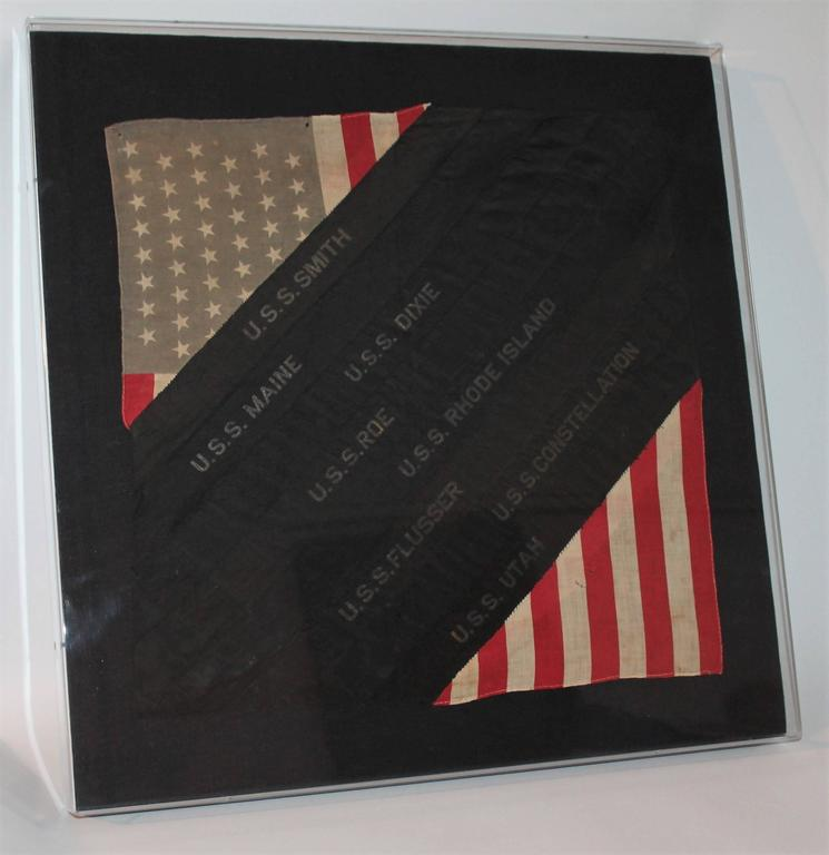 This Great framed Folk Art sham with 48star flag and ship ribbons is a great patriotic item. The top left corner as well as the bottom right corner are scraps of a 48 star linen flag and in between them are ribbons of ships names that are sewn