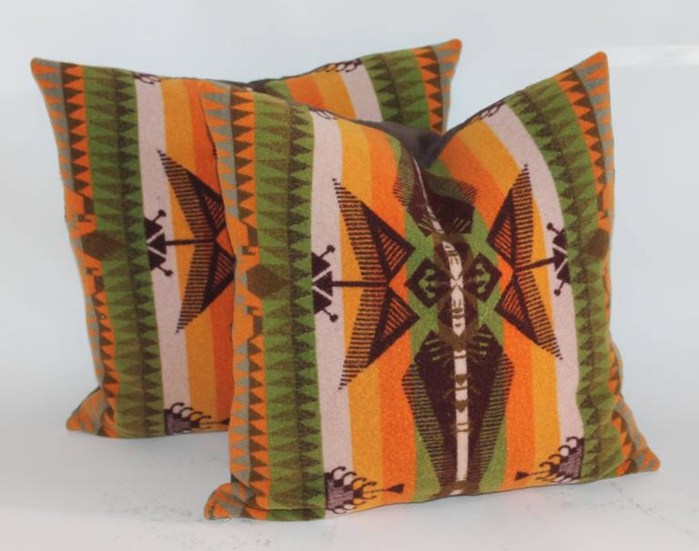 These fine and most unusual Indian design camp blanket pillows are in pristine condition and have chocolate cotton linen backings. Down and feather fill.