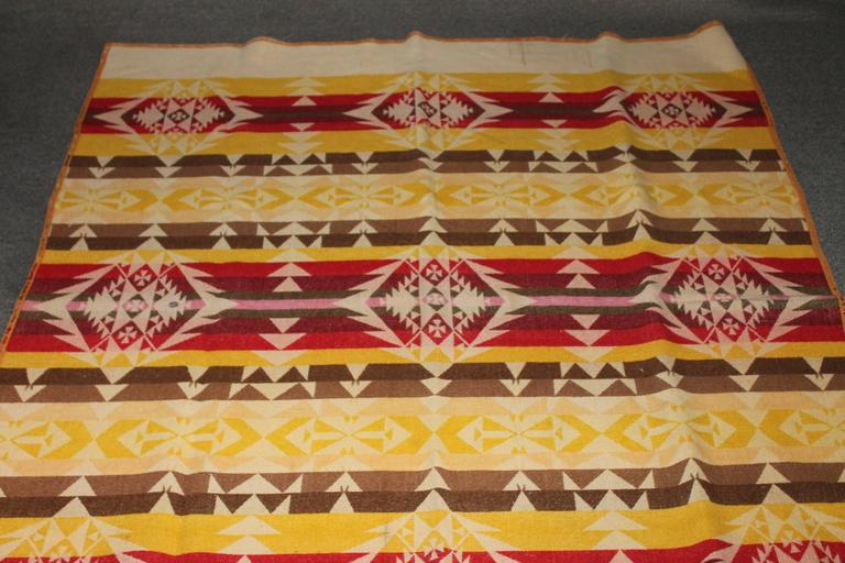 This early Pendleton Cayuse wool blanket is in fine condition and has the original label. It is dated 1909 on the label. The binding has minor wear.