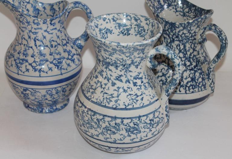 This fine group of pristine condition sponge ware pottery pitchers are in three slightly different blues and patterns. Sold as a group.