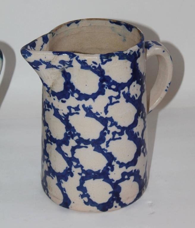 These tall patterned spongeware pitchers are in good condition with minor wear on the one pitcher to left its spout has warn down on the top. It does not detract from it's beauty. Sold as a group.