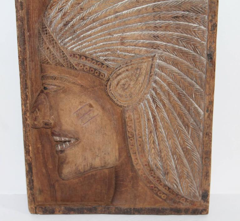 This very folky hand-carved Indian chief plaque is in great condition. This folky Indian is very well detailed carving. The condition is very good.