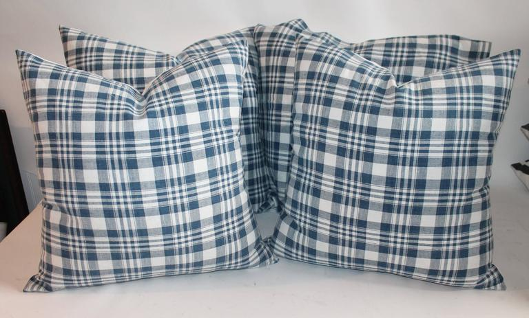19th century blue and white homespun linen pillows. Measure: Two pairs of 20 x 20 and two pairs of 22 x 22. Sold as pairs.