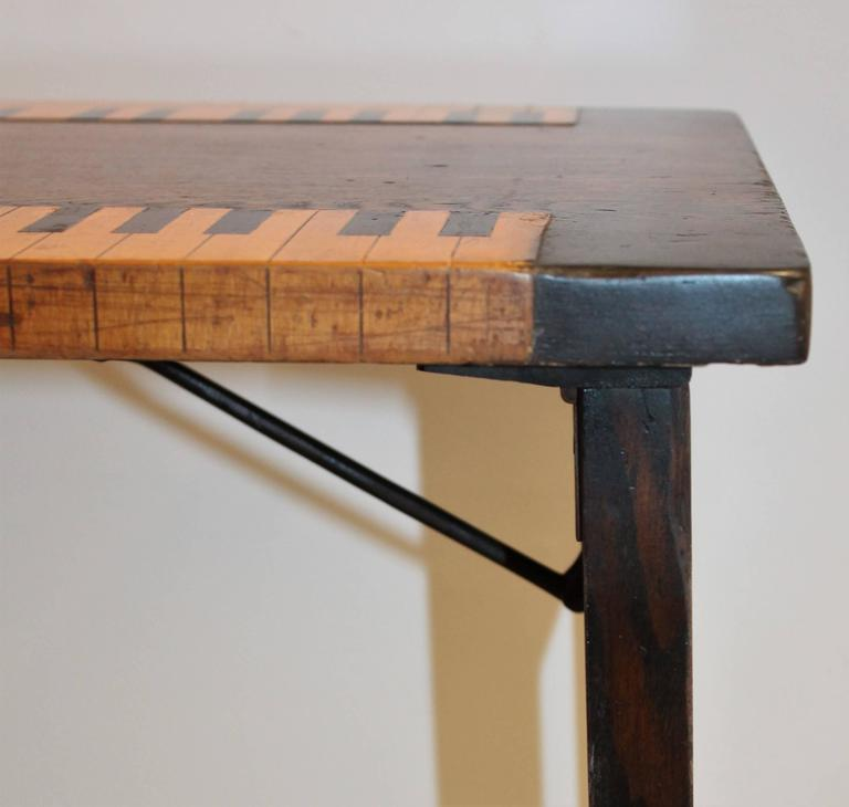This folky handmade and inlaid Folk Art piano table is amazing and is dated on the iron hinges January 2, 1883. This is a sturdy folding table and a great addition to any Folk Art collection. Such an unusual table and could even work as a sofa table!