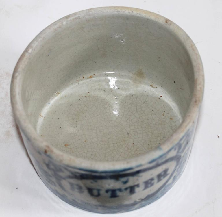 This handmade and painted butter crock was found in Pennsylvania and is in good condition with the exception of the old repairs to the lid. The base has no cracks or chips.
