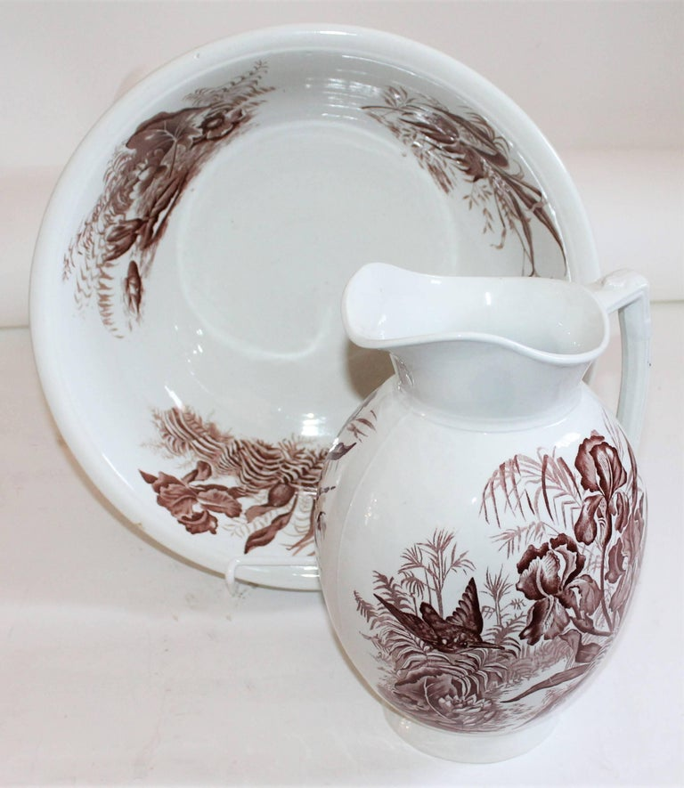 This mellow country floral brown and white transfer ware ironstone pitcher and bowl matching set. Signed F, W, & Company / England. The condition is very good.