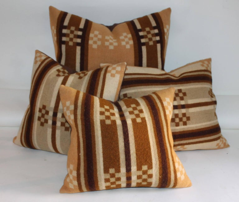 These amazing wool horse blanket pillows are in great condition with brown cotton linen backings. The inserts are down and feather fill. Sold as a collection of four pillows. The sizes are as follows: 14 x 14, 12 x 14, 15x 19, 18 x 21.