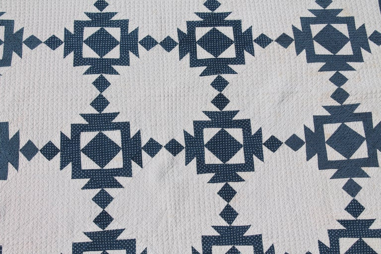 This finely quilted blue and white geometric quilt was found in Pennsylvania and is in very good condition. There is minor age spots the size of a pin head but no tears or damages.
