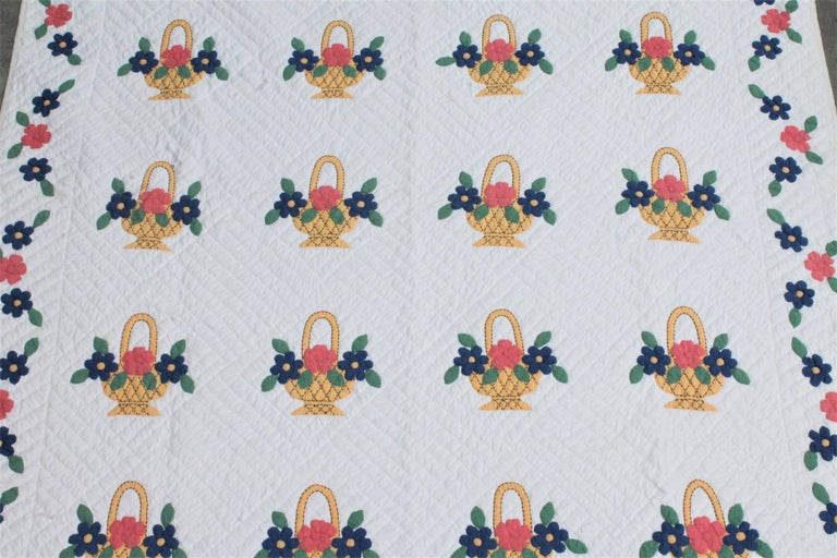 This 1930s applique pastel basket quilt is in good condition and very large in size.