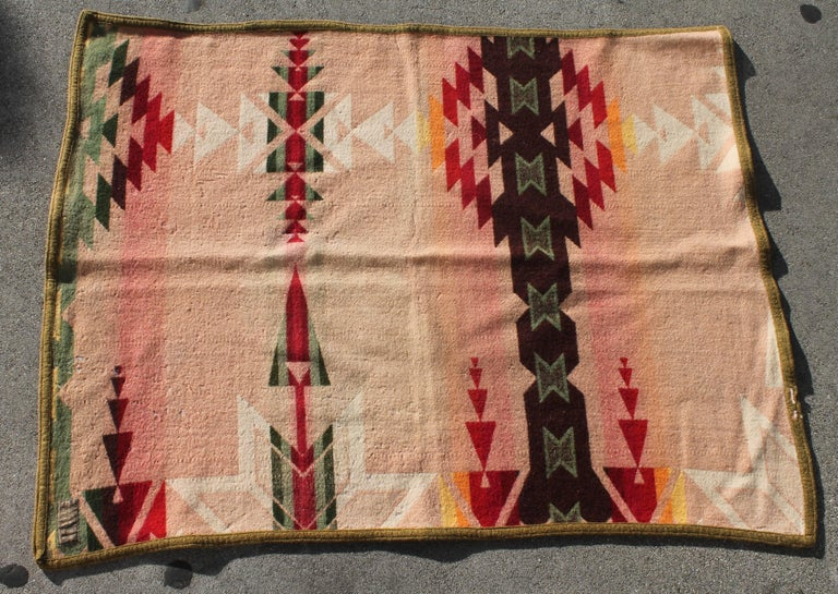 This Cayuse Pendleton Indian design camp blanket is in good condition. It is dated 1909 and retains the original label.