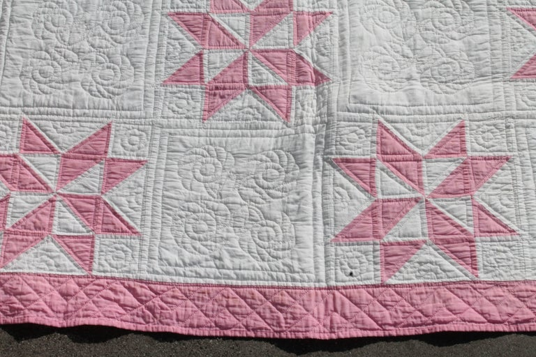 This early 19th century dusty rose eight point stars quilt is in fine condition and is loaded with cotton seeds. The quilting is very fine as well as the piece work too.