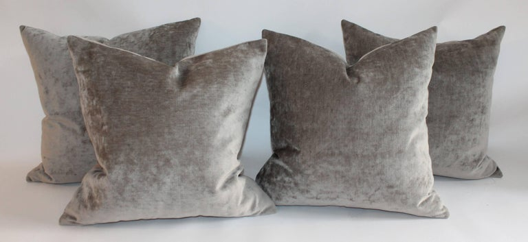 These olive or sage green velvet pillows are in amazing condition and are sold in pairs. The backings are in a taupe cotton linen fabric. There are three pairs in stock.