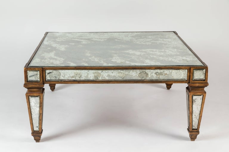 """A hard to find """"sick"""" antique mirrored cocktail table with a gold leafed wooden structure inlaid with antiqued mirror. A great square shape."""