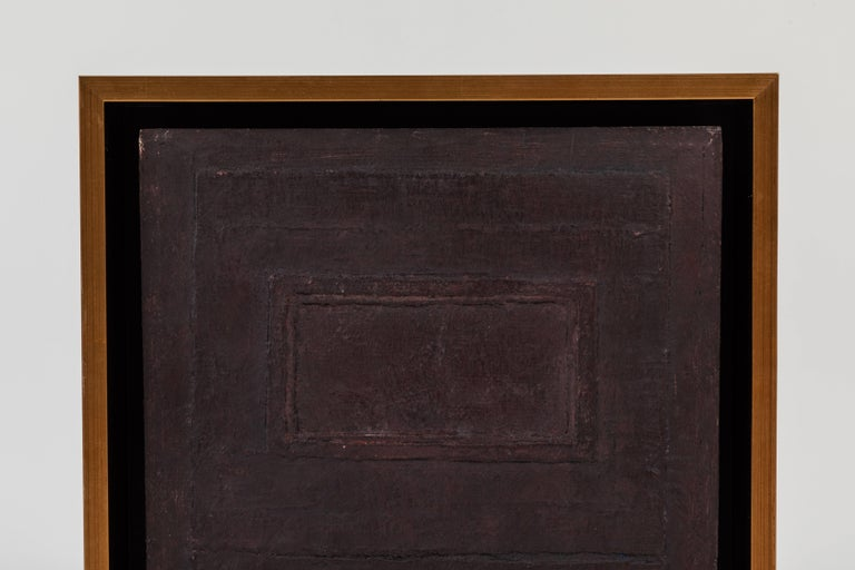 This abstract monochrome painting by little known Los Angeles artist is a fine example of color abstraction. The canvas has been painted with a monochrome, purplish brown paint that features two rectangular frames within the frame. The paint has