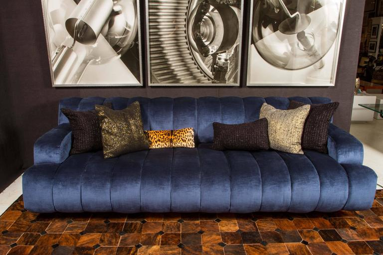 Channel quilted sofa and large-scale chair by Palm Springs Interior Designer, Steve Chase. Both have been newly upholstered in a beautiful Duralee blue velvet and have illuminated kick bases. The illumination is an original feature but the lights