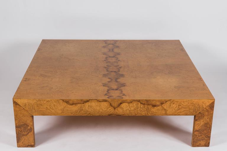 Beautiful low profile cocktail table constructed with book match burl wood veneers.