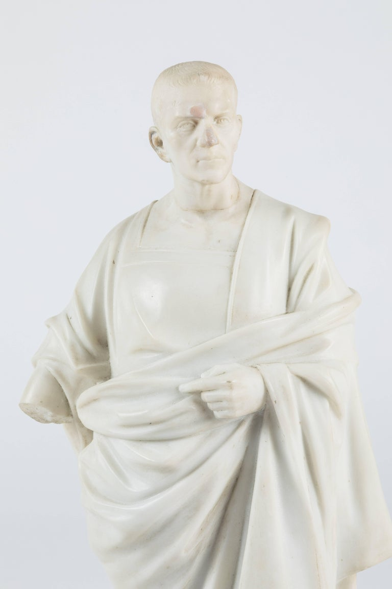 An intricately carved marble statue of a robed Roman official (possibly Marcus Tullius Cicero). This statue has extensive restorations so if you are looking for a perfect piece this one is not for you, but if you embrace a patina you are in luck.