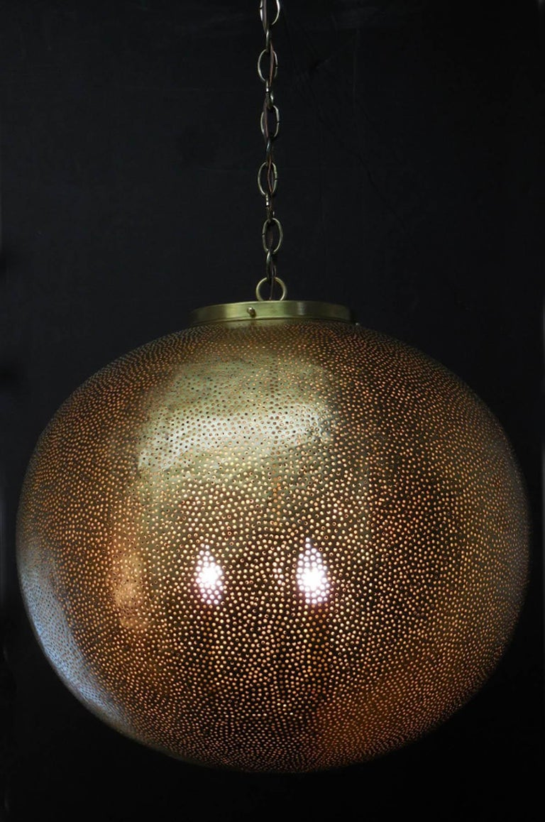 Pair of large lanterns, in hammered metal with hand finished matte bronze finish. Rewired in the US. Tiny circular cut outs. Three interior lights. Comes with chain in antique bronze finish. Ready for installation! Sold separately!