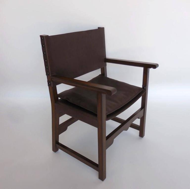 """Leather sling back and seat with a low profile seat cushion. Walnut frame with rubbed oil finish. Leather is com. Can be in custom sizes. As shown 26"""" W x 22"""" D x 36"""" H seat: circa 18 H. Arm height at 27 inches. Price does not include leather. Made"""