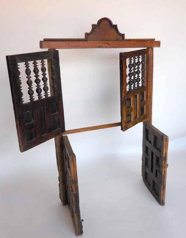 18th century wooden window shutters with panels and turned for Spanish style window shutters
