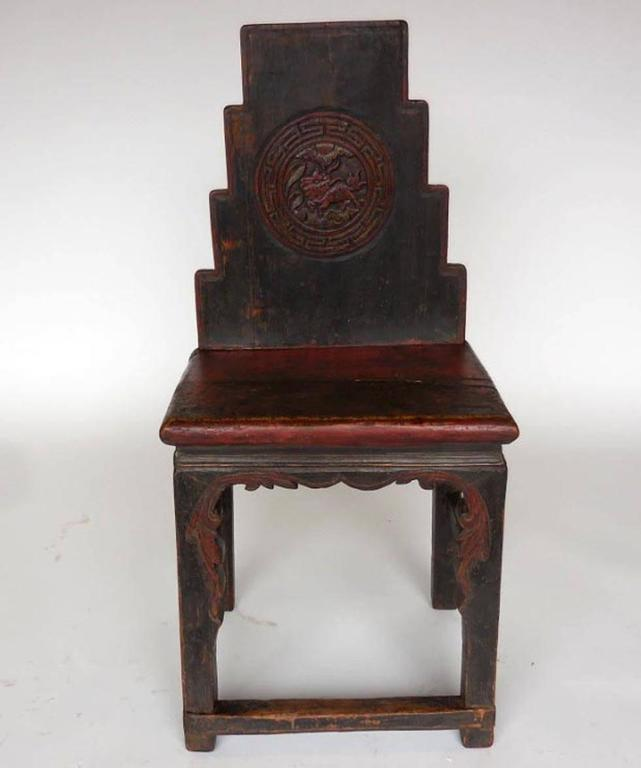 Early 19th century, all original Chinese chair with original red paint, and dragon and leaf carvings. Nice worn patina throughout.