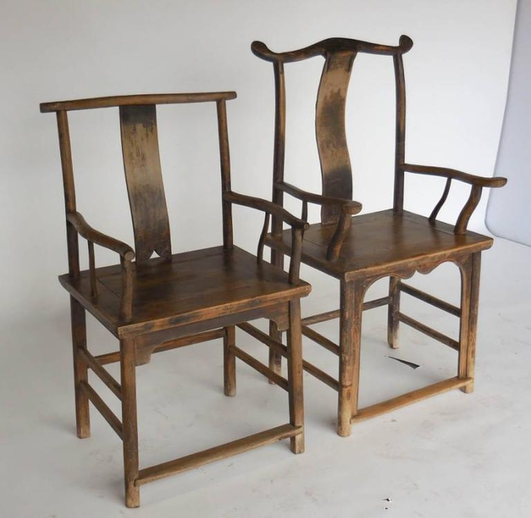 Striking pair of woman and man's chairs in elmwood in very good condition. Handsome. bentwood, branch like, with naturally aged patina. Some old repairs add to character. Mortise and tenon construction, hand-carved. Substantial and in very good