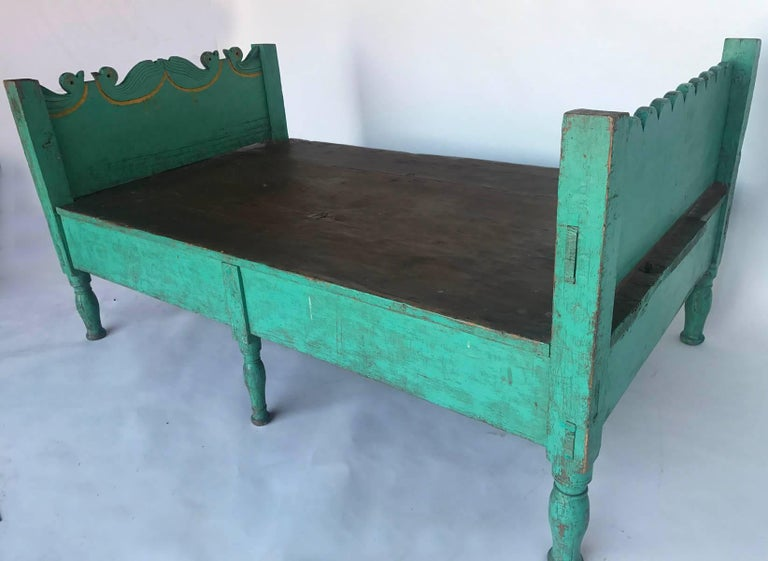 Whimsical, rustic  painted green bed with carved bird motif. Turned legs, great old worn painted patina. Mortise and tenon construction. Great fun!