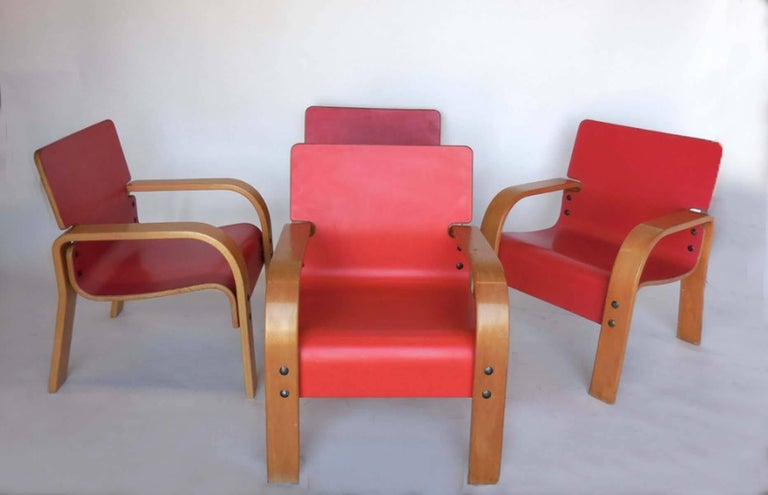 Four bent plywood coral/orange lounge chairs from the 1970s. In very good shape with very little wear. One chair is a bit lighter than the others. Can be sold separately.