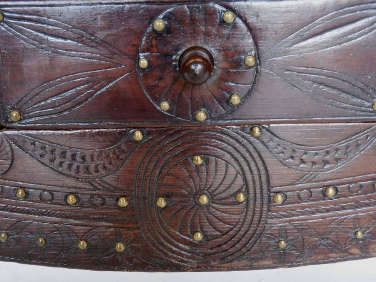Where colonial Spain and indigenous Guatemala meets, here is a Nahuala (animal spirit) table with carved lion foot front legs and animal inspired carvings and typical Spanish Colonial turned back legs. Three drawers, all dove tail construction.