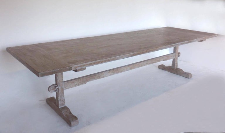 Custom classic trestle table in oak with an opened grain ceruse finish, done in a snow on sand color. Wide breadboards, delicate features. Beautiful. Top thickness is about one and three quarters thick. Can be made in any size and finish, in oak,