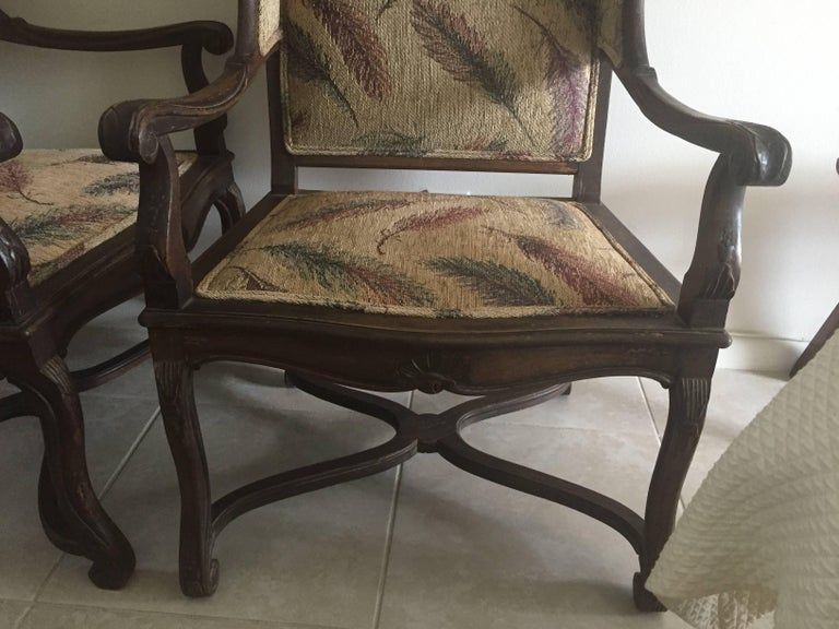 Stained Pair of Late 19th Century French Provincial Louis XVI Style Modified Wing Chairs For Sale