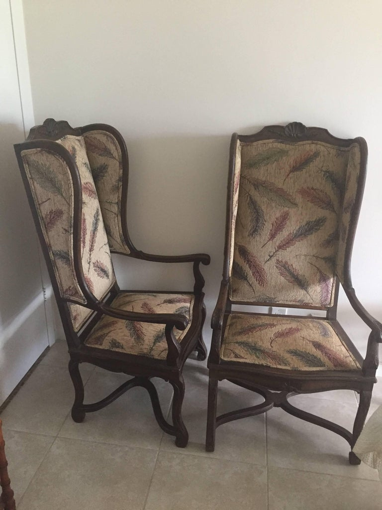 Pair of late 19th century French Provincial walnut Louis XVI styled modified wing chairs oversee in a brunshwig twill with feather motif.