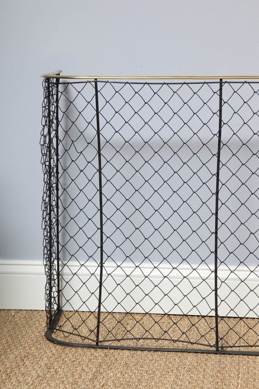 19th century English brass trimmed wrought iron nursery guard with wide